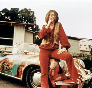 American singer-songwriter Janis Joplin (1943 - 1970) with her 1965 Porsche 356C Cabriolet, circa 1969. The car features a psychedelic paint job by Joplin's roadie, Dave Richards. (Photo by RB/Redferns)
